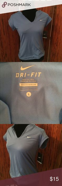 Nike Dri Fit Ladies NWT V-neck Size Large Nike Dri Fit Ladies V-neck Light Blue Top. NWT.  Comes from smoke-free and pet-free home. Questions and offers welcomed! Thanks for looking! Nike Tops Tank Tops