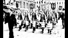 """Ukrainian women march in celebration of the formation of the Waffen-SS 14th Grenadier Division """"1st Galician"""" Ukrainian foreign legion. Spring, 1943. Lviv, Eastern Galicia. Contrary to common belief, Adolf Hitler did not view all Slavs as universally inferior. Those hailing from the former Austro-Hungarian imperial territory of Galicia (now part of the Ukraine) particularly were highly regarded by Hitler, even allowing them their own legion within his prestigious SS."""
