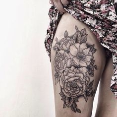 Illustrated black and gray floral thigh piece tattoo