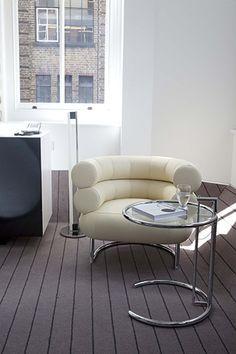 Lounge chair Bibendum with TubeLight E1027 and adjustable table