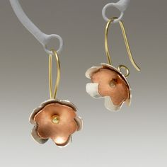 Pretty! I like copper a lot, and flower-based jewelry. (Plus, made in Kenya!)
