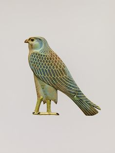 Inlay in the form of the Horus falcon    Period:      Late Period–Ptolemaic Period  Date:      4th century B.C.  Geography:      Egypt, Middle Egypt, Hermopolis (el-Ashmunein)  Medium:      Faience, polychrome  Dimensions:      H. 6 1/8 in. (15.5 cm)