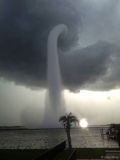 A Waterspout in Florida - What's happening over the water? Pictured here is one of the better images yet recorded of a waterspout a type of tornado that occurs over water. Waterspouts are spinning columns of rising moist air that typically form over warm water. Waterspouts can be as dangerous as tornadoes and can feature wind speeds over 200 kilometers per hour. Some waterspouts form away from thunderstorms and even during relatively fair weather. Waterspouts may be relatively transparent…