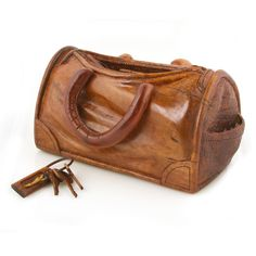 Handbag carved in wood by Big Island craftsman Perry.  Only at Martin & MacArthur