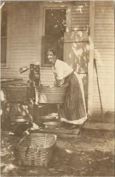 1916 Farm Gal in Apron on the Porch doing Laundry