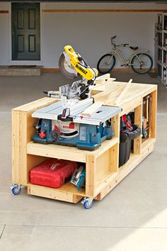 Mobile tool bench woodworking plan. This all-in-one shop on wheels combines three workhorse tools—a mitersaw, benchtop tablesaw, and table-mounted router—with a worksurface, space for a dust-collecting vacuum, and a ton of storage. Roll it out for marathon woodworking sessions; then park it back in the garage at the end of the day. Our step-by-step plans show you how to customize it to fit your tools.