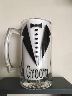 A personal favorite from my Etsy shop https://www.etsy.com/listing/262896898/groom-beer-mug-groomsmen-beer-mugs
