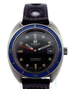 TISSOT NAVIGIGATOR AUTOMATIC CIRCA 1974, vintage Tissot Navigator. Automatic CAL 2481 movement with unusual, blue bezel, orange second sweep and date window at 3 o'clock...