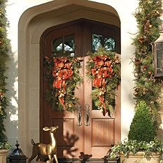 fabulous greenery for a holiday entry - love the reindeer, too