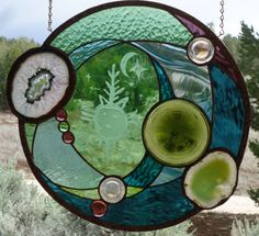 *************************READY TO SHIP*********************** ALL PHOTOS TAKEN WITH NATURAL LIGHT!! NOT PHOTO SHOPPED!! ZUNI SUNRISE ancient petroglyphs that were pecked in the sandstone cliffs of the Zuni Pueblo are still around today, We sand carved the petroglyphs, on European hand blown glass, used antique cast glass pieces, Brazilian agates, glass nuggets, & hand poured & rolled glass. COPPER/ BRONZY/ FINISH OR BLACK LUSTER SIZE.... 16 1/4 ROUND,,,,, 1...