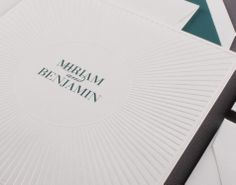 Our Radiant Circle invitation is shown in detail here thermography printed in teal ink.