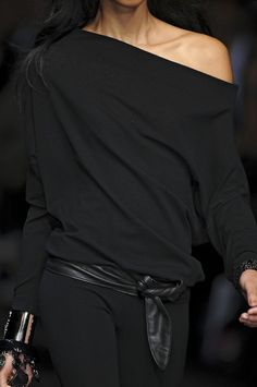 Black off the shoulder top with leather belt, by Donna Karan.