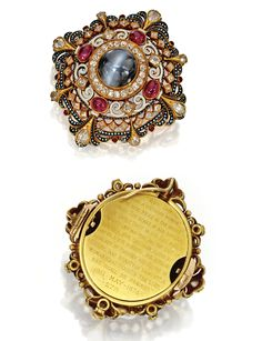 GOLD, CAT'S-EYE CHRYSOBERYL, RUBY, DIAMOND AND ENAMEL PENDANT-BROOCH, CARLO GIULIANO,  1863-1895   Of Renaissance Revival-Style, the circular bombé form set in the center with a cabochon cat's-eye chrysoberyl measuring approximately 14.0 mm., accented by oval and round cabochon rubies, and old mine and antique pear-shaped diamonds, applied with white and black enamel, signed C.G