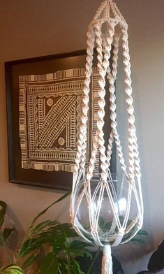 A beautiful ode to Vintage Macramé Plant Hangers! The Cambie Macramé Plant Hanger is pictured on the left of the first picture alongside a Triple Elsa Macramé Plant Hanger that you can find here http://etsy.me/2sb2NwR. The modern twist is with this Natural White Cotton Cord (as