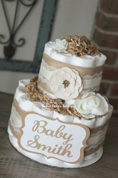 EACH CAKE IS HANDMADE TO ORDER - PLEASE ALLOW 1-2 WEEKS PLUS SHIPPING TO RECEIVE YOUR ORDER- Please check my shop homepage to see if I am still accepting orders for your event date. https://www.etsy.com/shop/BabeeCakesBoutique?ref=hdr_shop_menu Small 2 Tier Neutral Shabby Chic { Burlap & Lace w/ Ivory, White & Kraft Accents } -------------------------------------------------------------------- ○ 27 size 1 Pamper Swaddlers (8-14lbs) - Diapers are compl...