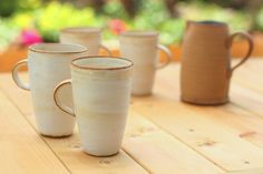 This large mug is great for slow coffee drinkers. Its volume is about 10,5 oz. (300ml) and due to the nature of ceramics, the mug will keep the