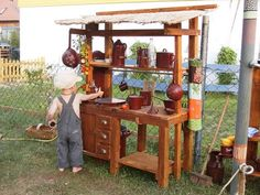 Outdoor play kitchen. love this one!