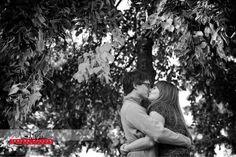 Kissing under a tree. #fallportrait #couple #portraiture #idaho #coeurd'alene