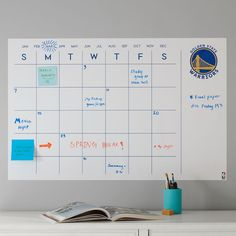 Whether you're tracking your team's upcoming games or your own plans, this NBA decal calendar makes planning fun. It has a peel-and-stick backing that's easy to apply, reposition and remove, and also comes with an erasable pen.  Pottery Barn Teen NBA Team Logo Decal Calendar