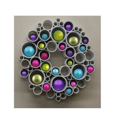 How to Use PVC Pipe for a Recycled Art Wreath. Watch the video and learn how to use PVC pipe for a modern take on wreath ideas using recycled materials. Thanks to Etsy Shop 'Red Sketch Door' for letting us feature! Pvc Pipe Crafts, Pvc Pipe Projects, Diy Crafts, Lathe Projects, Holiday Wreaths, Holiday Crafts, Christmas Projects, Christmas Crafts, Xmas