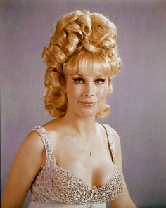 Barbara Eden - not just Barbara, but the 60s 'do'. Curls placed all over the head, and gobs of hair 'laquer' to keep it in place - for some a week - until next visit to the hairdresser. Using shower caps and satin pillow cases and even toilet paper wrapped around the hair to sleep, so it wouldn't dislodge.