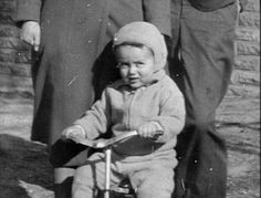 Baby Jimmy on his little tricycle