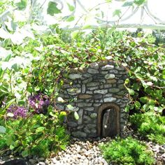A functional planter that looks like a cobblestone cottage.