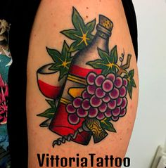 Traditional wine bottle and grape tattoo healed tattoo Tattoos by Vittoria Via A.Volta 49 Côme Tattoo Shop #winebottletattoo #grapetattoo #alcoholictattoo #traditionalwinetattoos #comotattoos #vittoriatattoos #toyatattoos