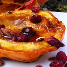 Candied Acorn Squash-  acorn squash, halved and seeded, place cut side up on a microwave-safe plate. Put 2 Tbsp butter, & 2 Tbsp brown sugar in each half.  Microwave 8 to 10 minutes on full power. When the flesh is soft. Serve in the shells.  Can cut each in half for  4 servings.  Sprinkle with Craisins