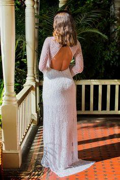 This gown is our ultimate statement piece.  All Hand beaded dress with high neck and stunning backdrop. #bellsleeves #longsleeves #handbeaded #madeinmelbourne #lowbackweddingdress #bridalinspiration2017 #eveningwear #bridal #shehzarin #shehzarinbatha #couture #weddingdress #gown