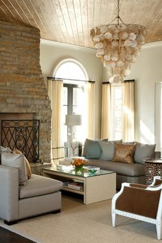 ceiling detail | exposed brick | shell hanging fixture