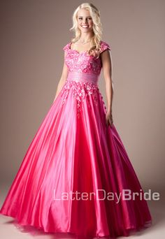 Shayna! Full A-line Ball Gown of Tulle with Embroidered Flower Appliques. A Wide Band accentuates the natural waist. In Fuchsia! $440.00