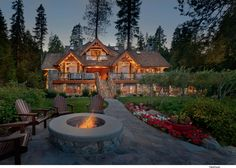 """This 6,800 square foot residence on the shores of Lake Tahoe was designed to maximize the potential of the lakefront site. The unique poplar bark siding and black locust log trim, railings, and fencing lend to the old Tahoe scale and charm."""