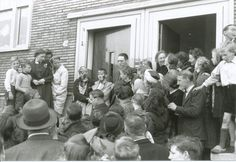 """May 7 or 8 1945. Neighbors at the Solebaystraat in Amsterdam have drawn a Swastika and written the word """"whore"""" on the face of two girls who have had dealings with German soldiers. Many people considered the end of the war also as the """"moment of revenge """", but the """"people's justice"""" was rejected by other Amsterdammers as immoral. #amsterdam #1945 #worldwar2 #Solebaystraat"""