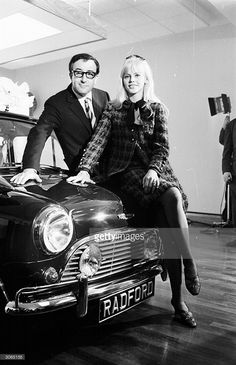Britt Ekland sitting on the Mini her husband Peter Sellers bought for her birthday, at the Radford Motor Company showroom, Hammersmith - London