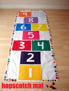 No sew canvas and felt game mat--hopscotch on one side, tic-tac-toe & bulls-eye on the other