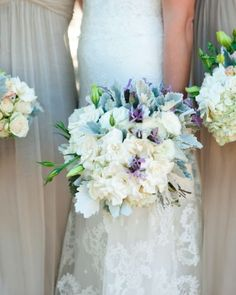 Lavender adds a subtle pop of color to this bouquet of garden roses, dusty miller, hydrangeas, and gardenias