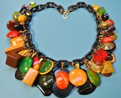 Rare unique ONE-OF-A-KIND necklace with 43 multicolor pendants of genuin tested vintage 1940s bakelite plastic with black plastic chain by NORDICART on Etsy https://www.etsy.com/listing/189325740/rare-unique-one-of-a-kind-necklace-with
