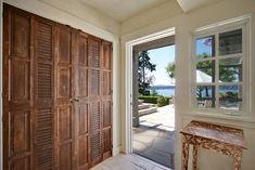 Mix of closet door types on entry closet - looks fabulous!