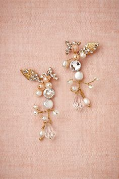 "Arctic Earrings from BHLDN Iced leaves of gold and pearl and crystal buds are set on slender branches of gold. Post is located in the center of the earring, behind the large crystal. From Cécile Boccara. 2""L, 0.75""W. Brass, silver plated brass, glass pearls, Swarovski crystals. Handmade in France."