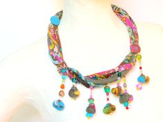 "This colorful fabric necklace is made of specially chosen strips of fabric, covered cords and Multicolored fabric braided tied together  One of a kind loop size~ 63 cm ~25""  $145"
