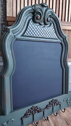 Repurposed headboard!  I think I'd like to see a mirror in it instead of the chalkboard...