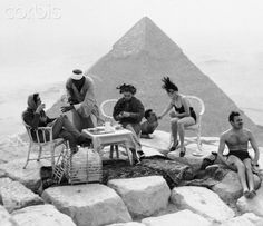 Tourists having tea on Top of Great Pyramid