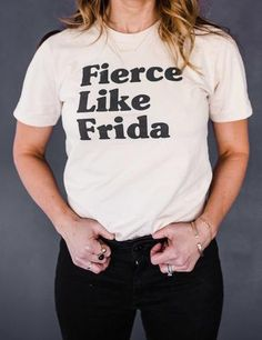 Frida Kahlo :: feminist icon and considered one of Mexico's most famous artists. No one can rock a uni-brow and head full of flowers quite like Frida!  Put FLF with jeans, yoga pants, or dress it up with a statement necklace and skirt! The possibilities are endless with this t-shirt....  Creme Fine Jersey Tee (100% Cotton) construction. Screen printed :: Unisex sizing, true to size. *Model wearing a small
