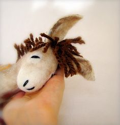 Made to order felt donkeys~ awesome! You've got to go to her site and see the most adorable felt animals.