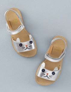 Explore the big horizons of sandy beaches or the rolling hills of the countryside in comfort with our trusty leather sandals. In four different ways including our super-sweet kitty with little button eyes.