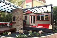 The focus for this project was to add outdoor living areas to this modern craftsman house. The steel pergola structure doubles to provide cover for the built in sunken seating and dining areas of the floating ipe deck. The conversation pit includes bright red outdoor cushions for a pop of color and comfort. The 14′ …