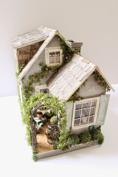"""This is my little """"Summer House"""" dollhouse. It oozes Cape Cod vintage style with the ease of summertime furnishings. This dollhouse i..."""