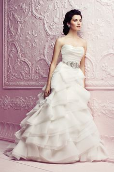 STYLE  4265 DESCRIPTION  Silk Duchesse and Organza wedding dress. Strapless ruched bodice with removable beaded appliqué sash. Covered buttons over zipper.  Folded Organza detailed skirt. Chapel Train.