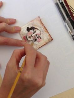 A close up video of me painting a face on a TeaBag